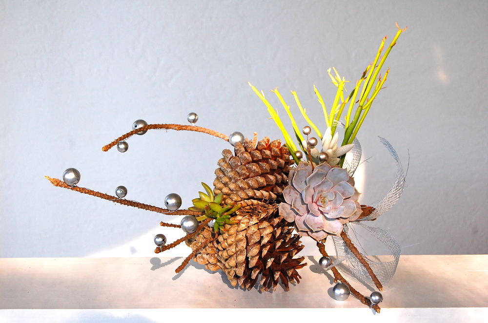 "SMALL PINECONE BRANCH   19""w x 9""h – $65."