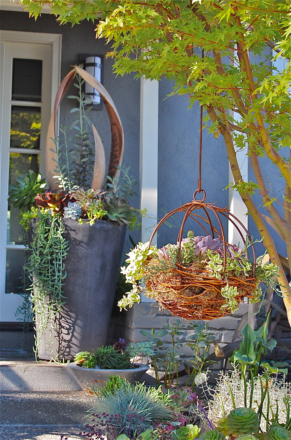 CUSTOM OUTDOOR PLANTER AND HANGING METAL ORB IN CORTE MADERA, CA