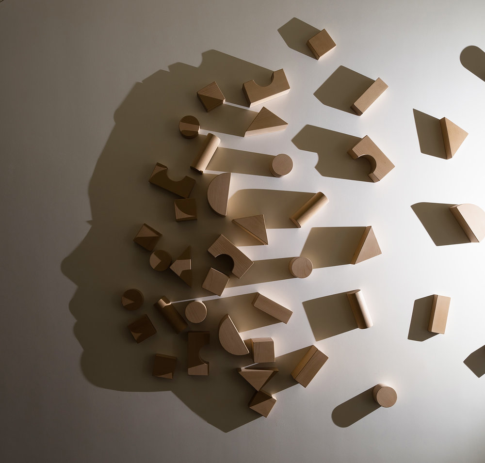 BUILDING BLOCKS   2014 H200, W300, D10 cm Carved wood, single light source, shadow Commissioned by Otsuma Women's University, Tokyo, Japan