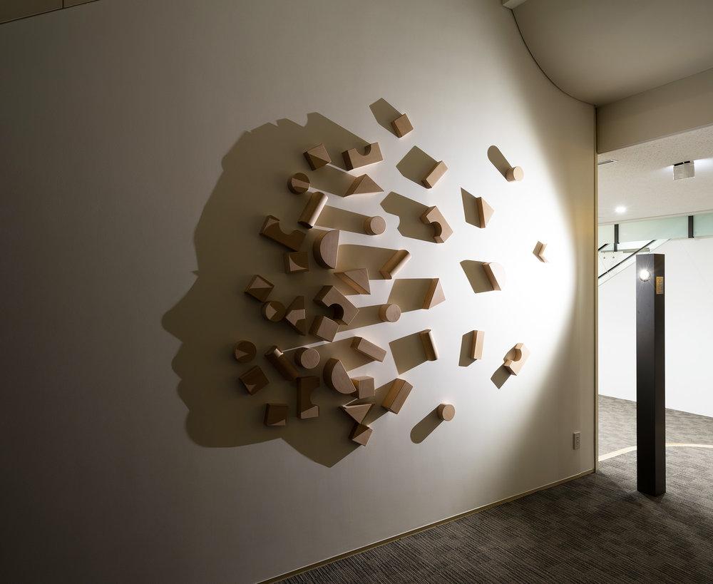 BUILDING BLOCKS   2014 H200, W300, D10 cm Carved wood, single light source, shadow Permanent Collection Otsuma Women's University, Tokyo, Japan