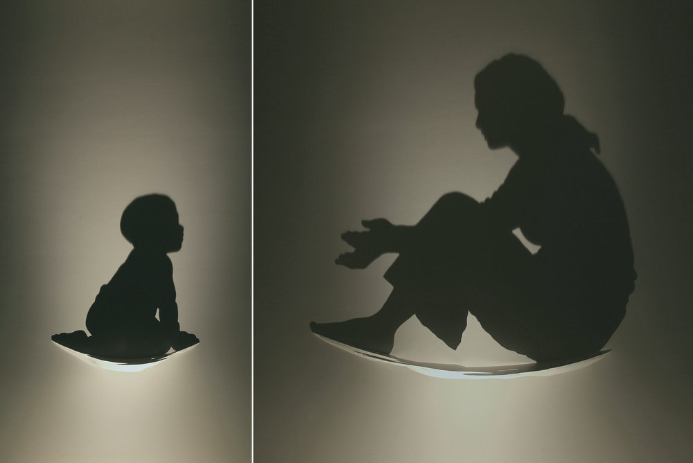 GLOW   2009 H90, W90, D15 cm (Mother) H45, W45, D11 cm (Child) Sculpted wood, single light source, shadow Commissioned by Perfe Takiyama Maternity Clinic, Tokyo, Japan