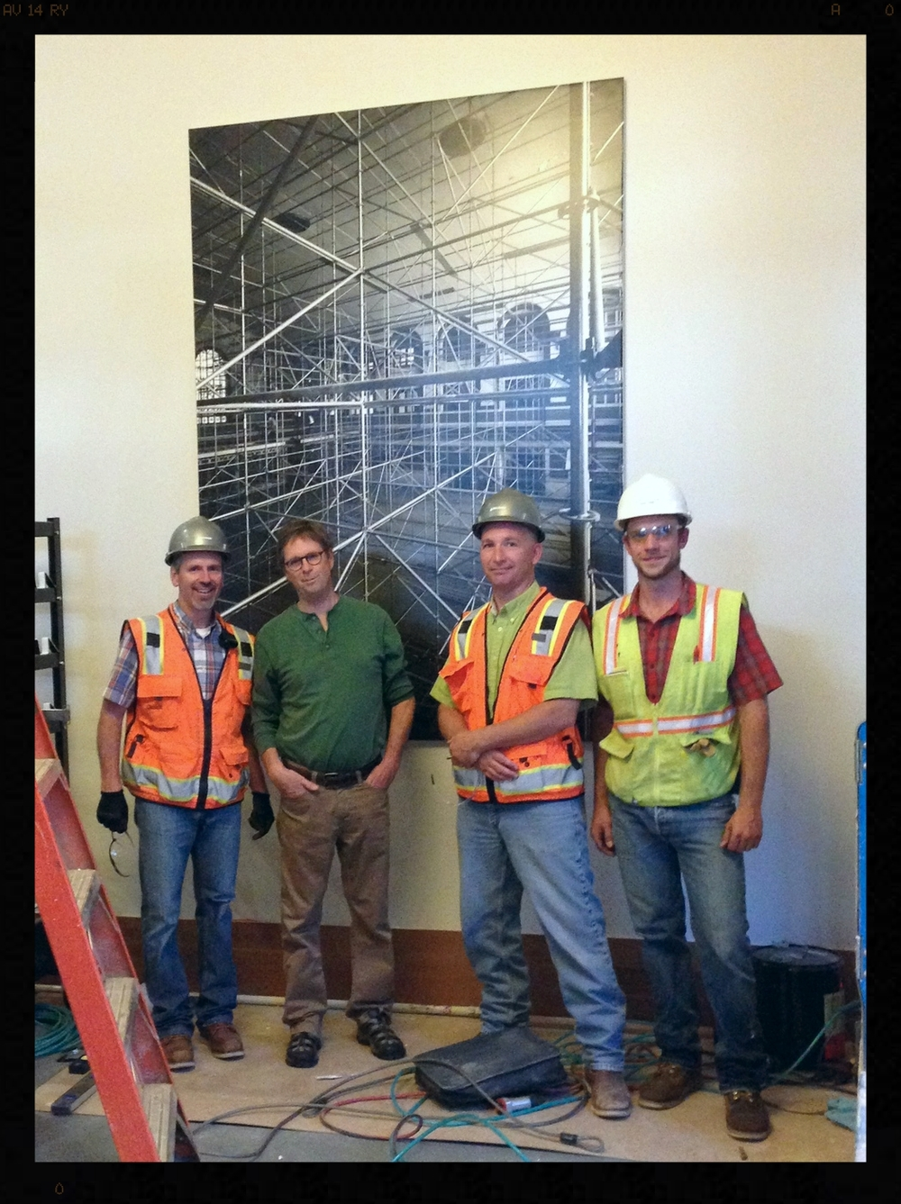 Giff with one of his prints and the construction team at Union Station