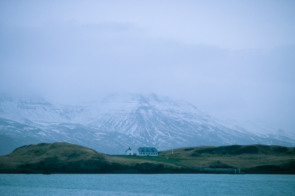 Today we flagged the coast guard over and had them take us to a surf spot in the city of Reykjavík. We caught some over head to double overhead waves off a point, then we got picked up and were served hot chocolate… This is a small glimpse into our backdrop. The Esja volcanic mountain range.