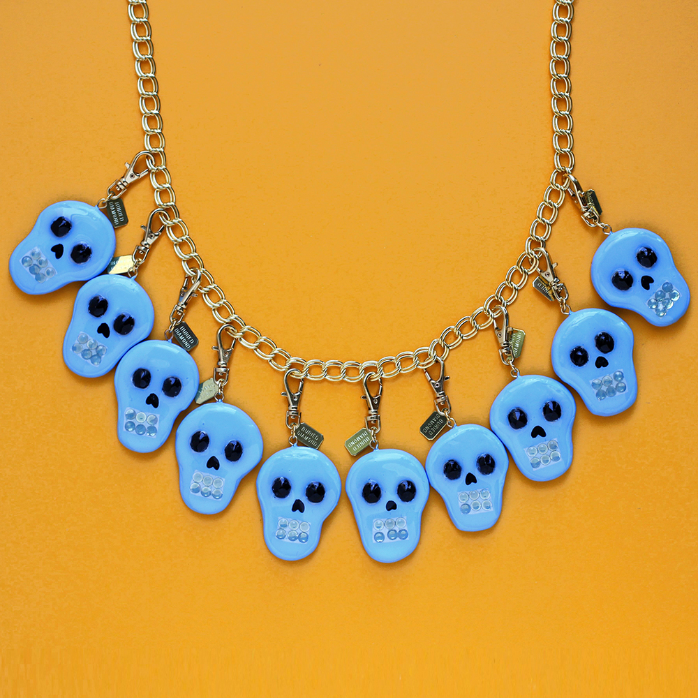 I make this charm every year, but always a different color. Skulls with Swarovski crystal teeth and vintage jet glass beads for eyes.