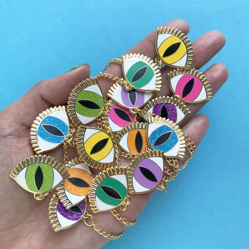 A classic Buried Diamond enamel design - the Magic Eye - these are collar pins in an array of colors.