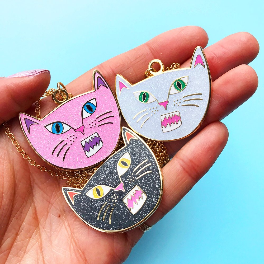 Enamel Snarling Cat pendant necklaces available in the shop.