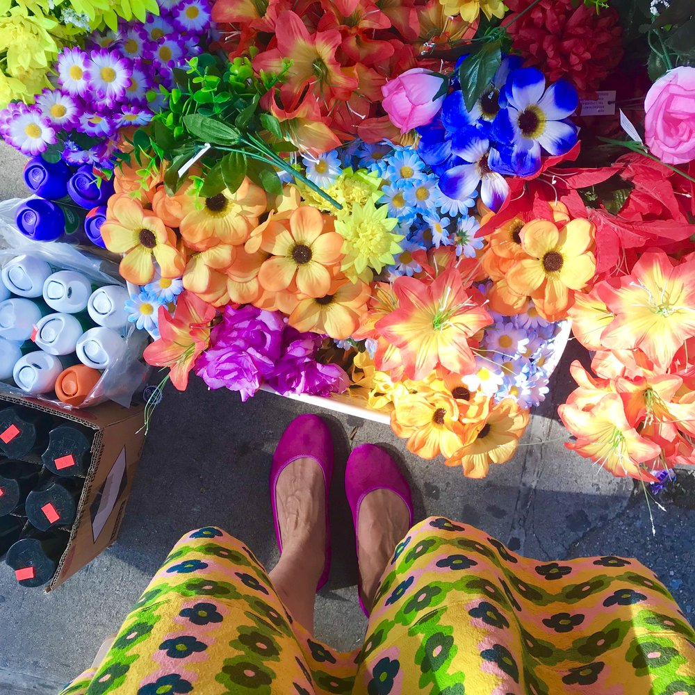 My neighborhood 99¢ store always has the best fake flowers out front. Wearing a dress I made, McCall's 7774.