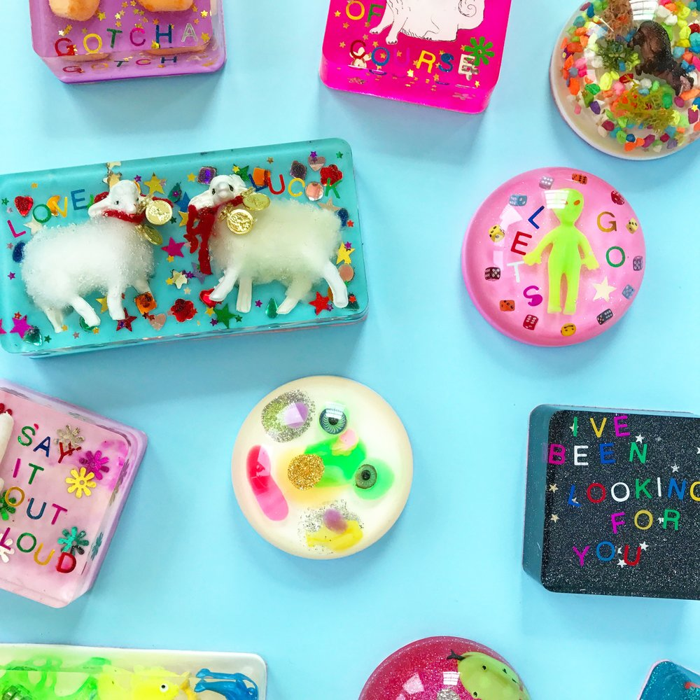 Some of my handmade paperweights! These are resin and many goodies poured into a mold. I got those little lambs in the markets in Mexico City. I use these as pattern weights when I'm cutting fabric to make clothes.