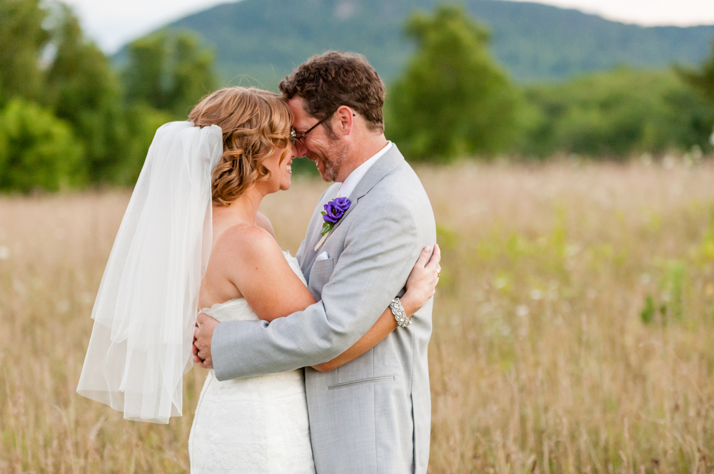 Bride and Groom in field at The Red Barn at Hampshire College in Amherst, MA
