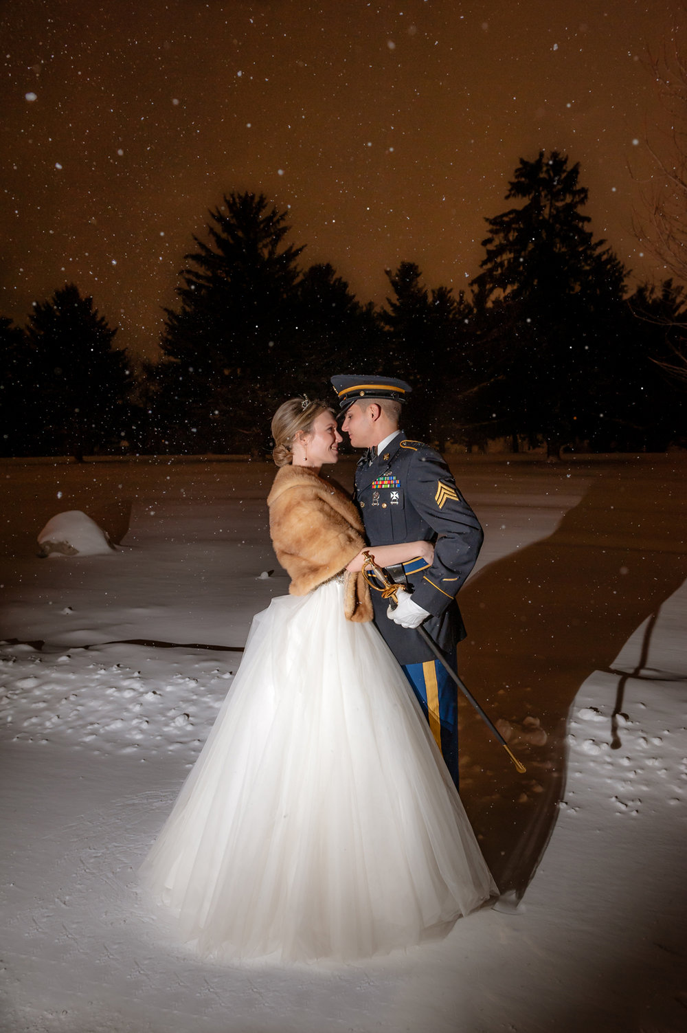bride and groom in snowfall Nashua Country Club