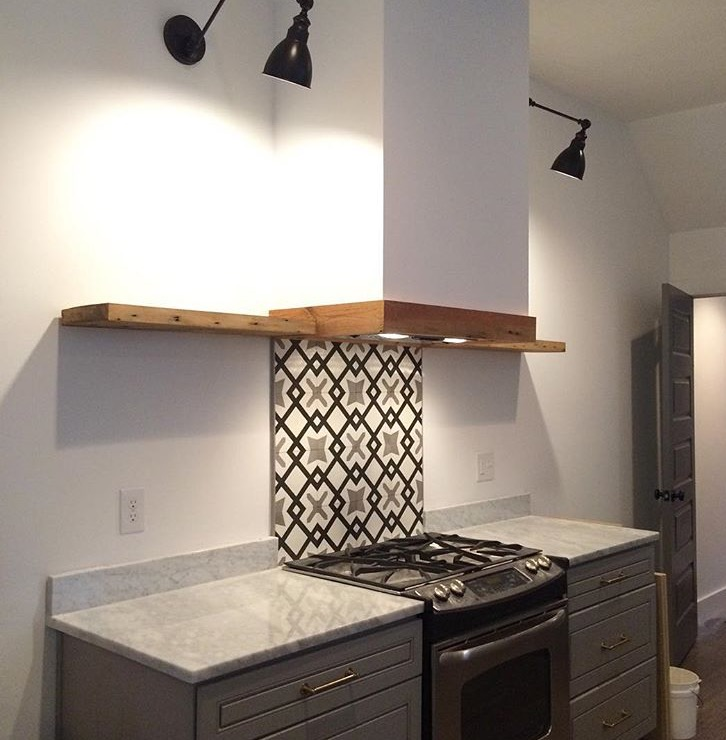 Gray kitchen with marble and cement tile