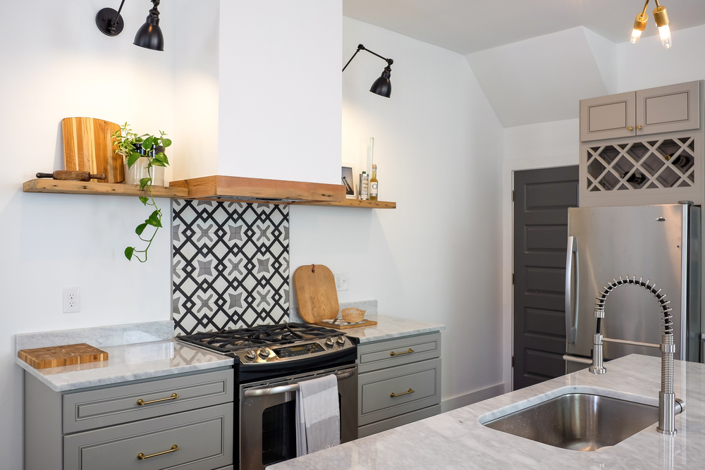 Floating Wood Shelves and Cement Tile Backsplash behind Range