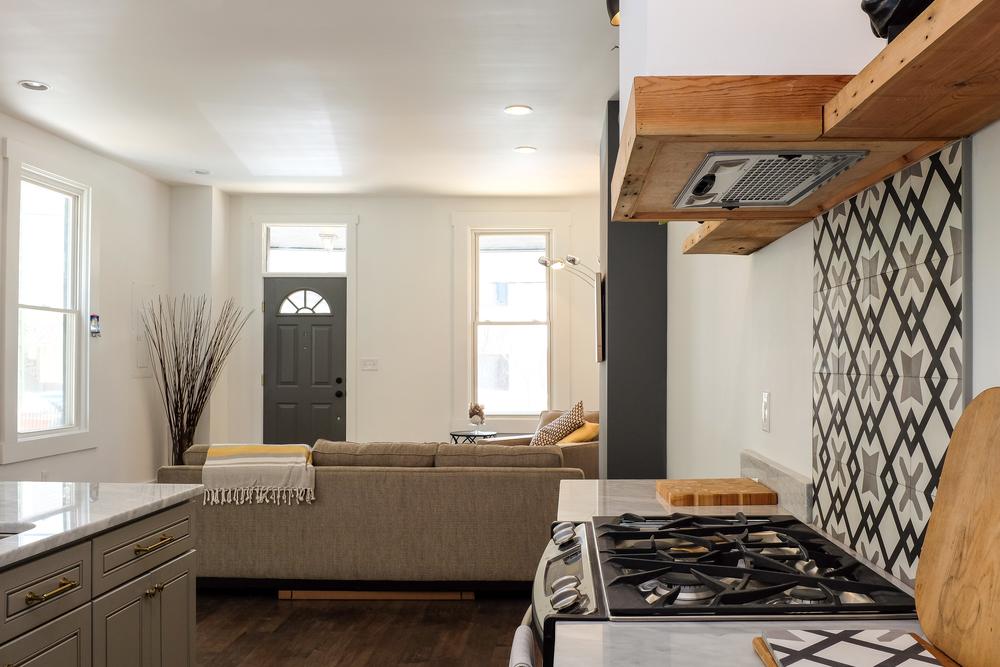 Custom kitchen range hood with floating salvaged wood shelves