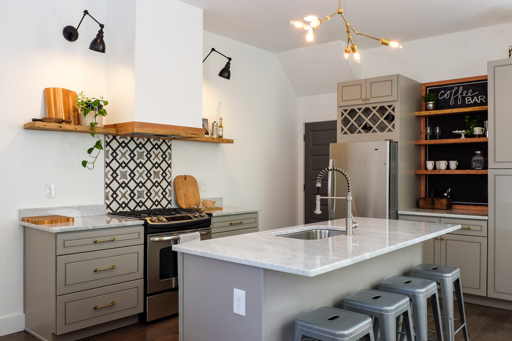Gray, Black and White Kitchen with Marble Counters and Cement tile Backsplash