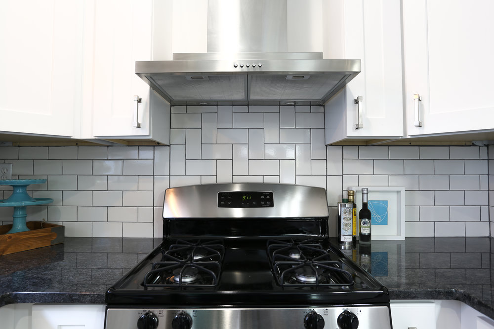 Herringbone Backsplash with white subway tile