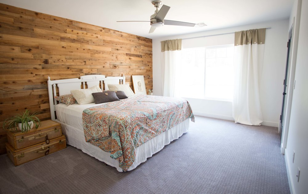 Cedar salvaged barnwood style wood accent wall master bedroom