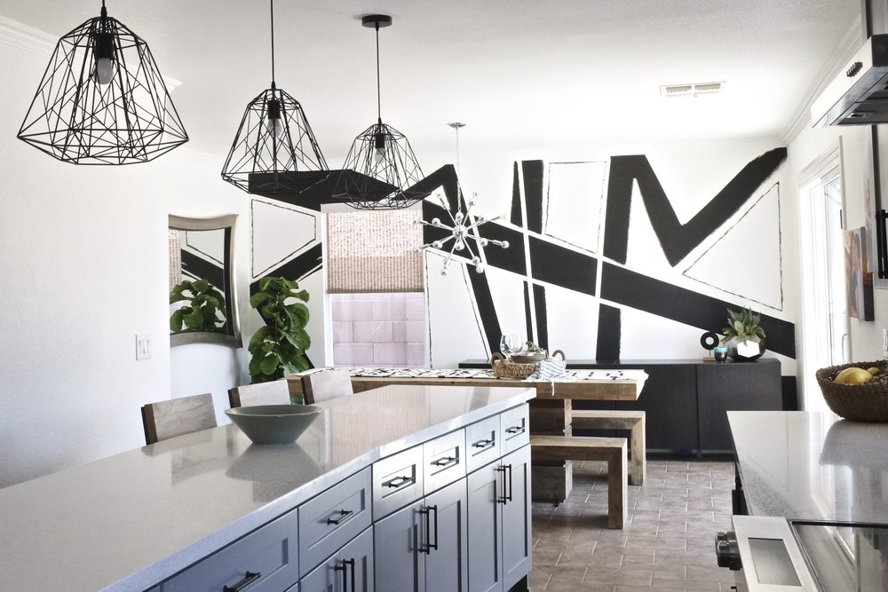 Gray Kitchen with Abstract Art Accent Wall