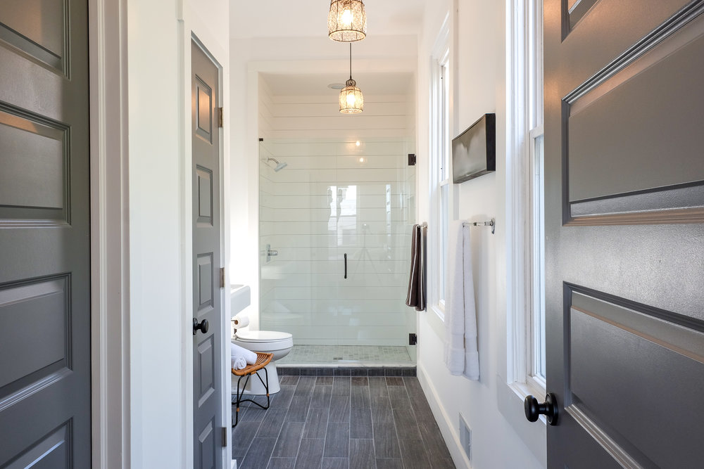 Closet and Bedroom turned Master bath with shiplap shower