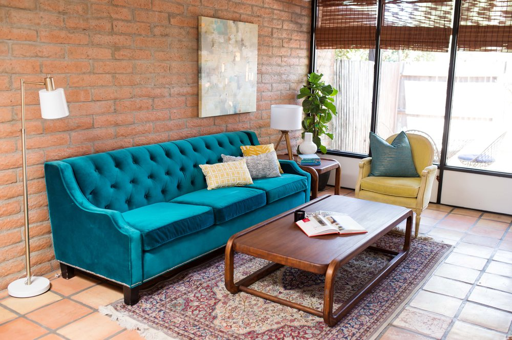 Turquoise sofa with vintage furnishings