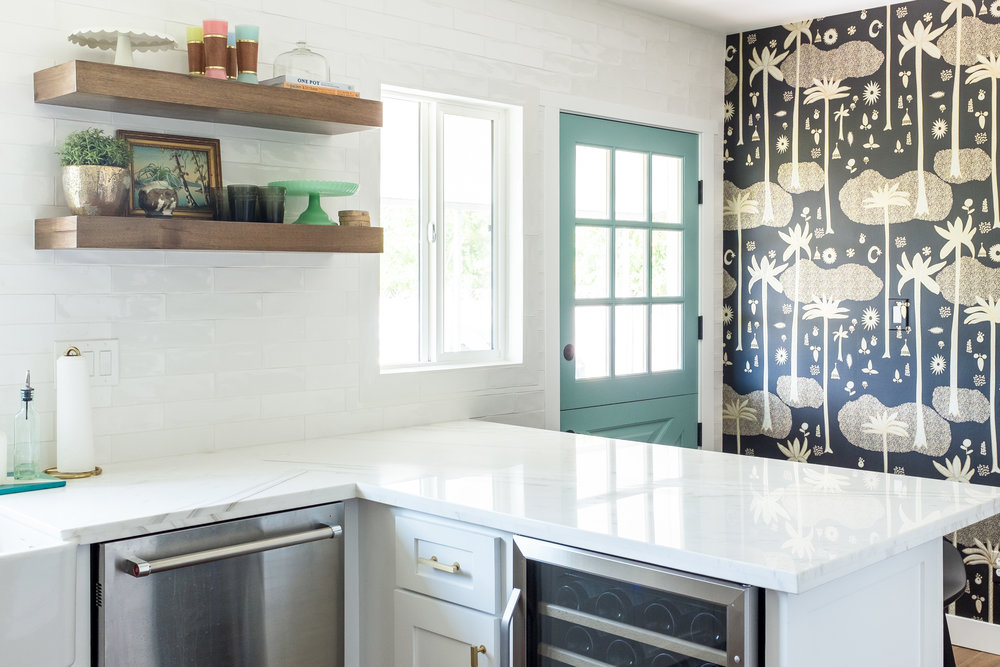 Justina Blakeney Wallpaper, Floating Shelves, Shaker cabinets with brass pulls and Dutch door