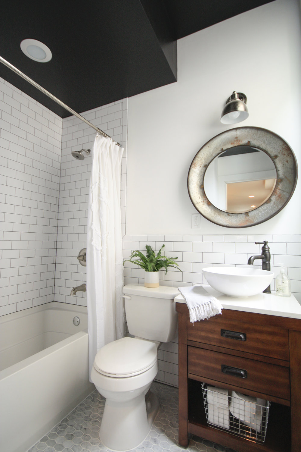 10 ways to use subway tile that arent boring af flippinwendy design black ceiling with white subway tile and dark grout dailygadgetfo Choice Image