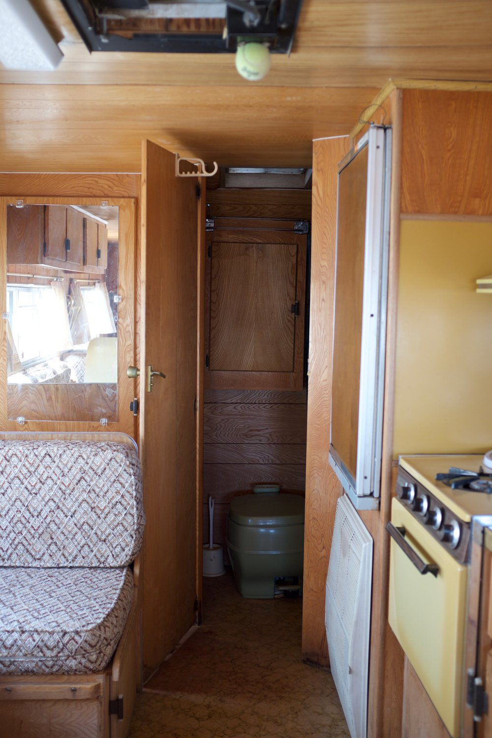 Camper interior vintage with olive green bathroom