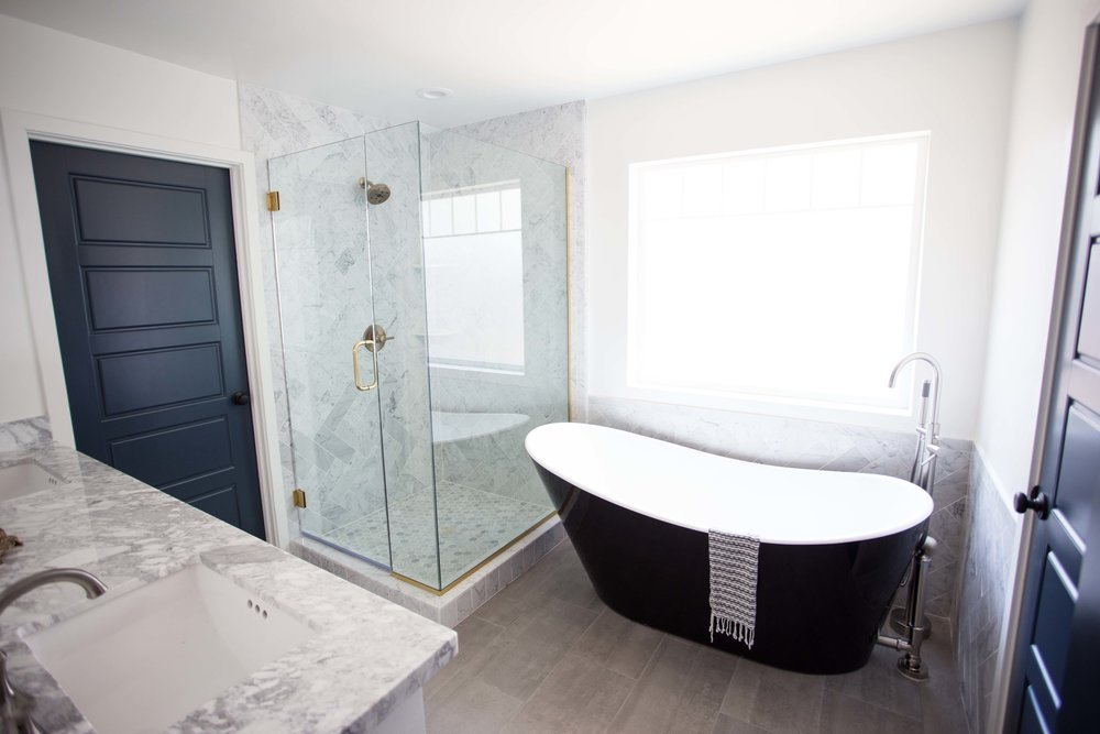 Black and white soaking tub master bath