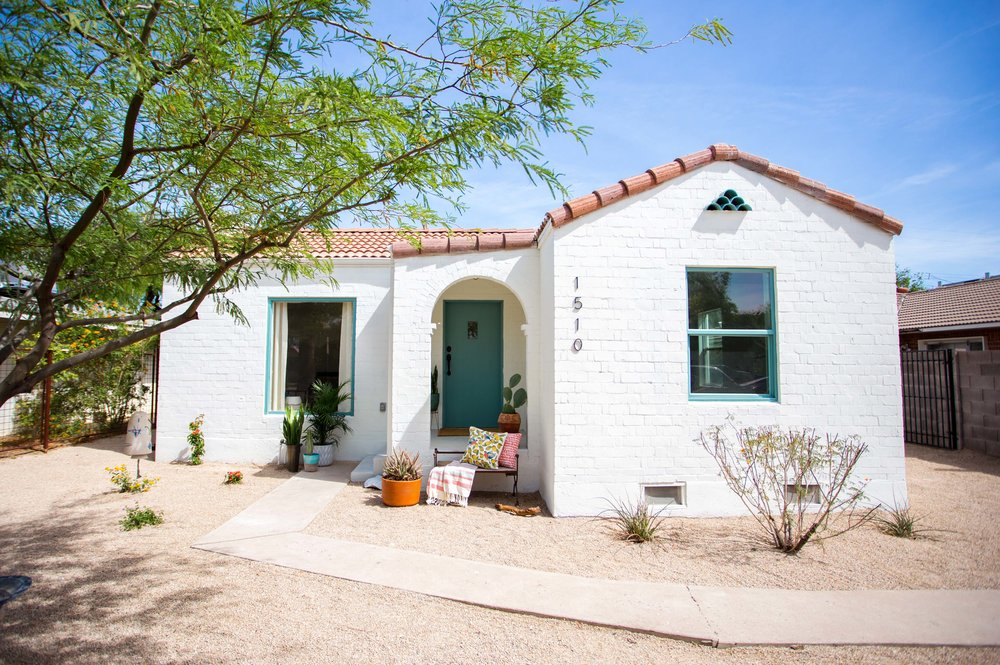 Almeria project spanish style white exterior with teal door