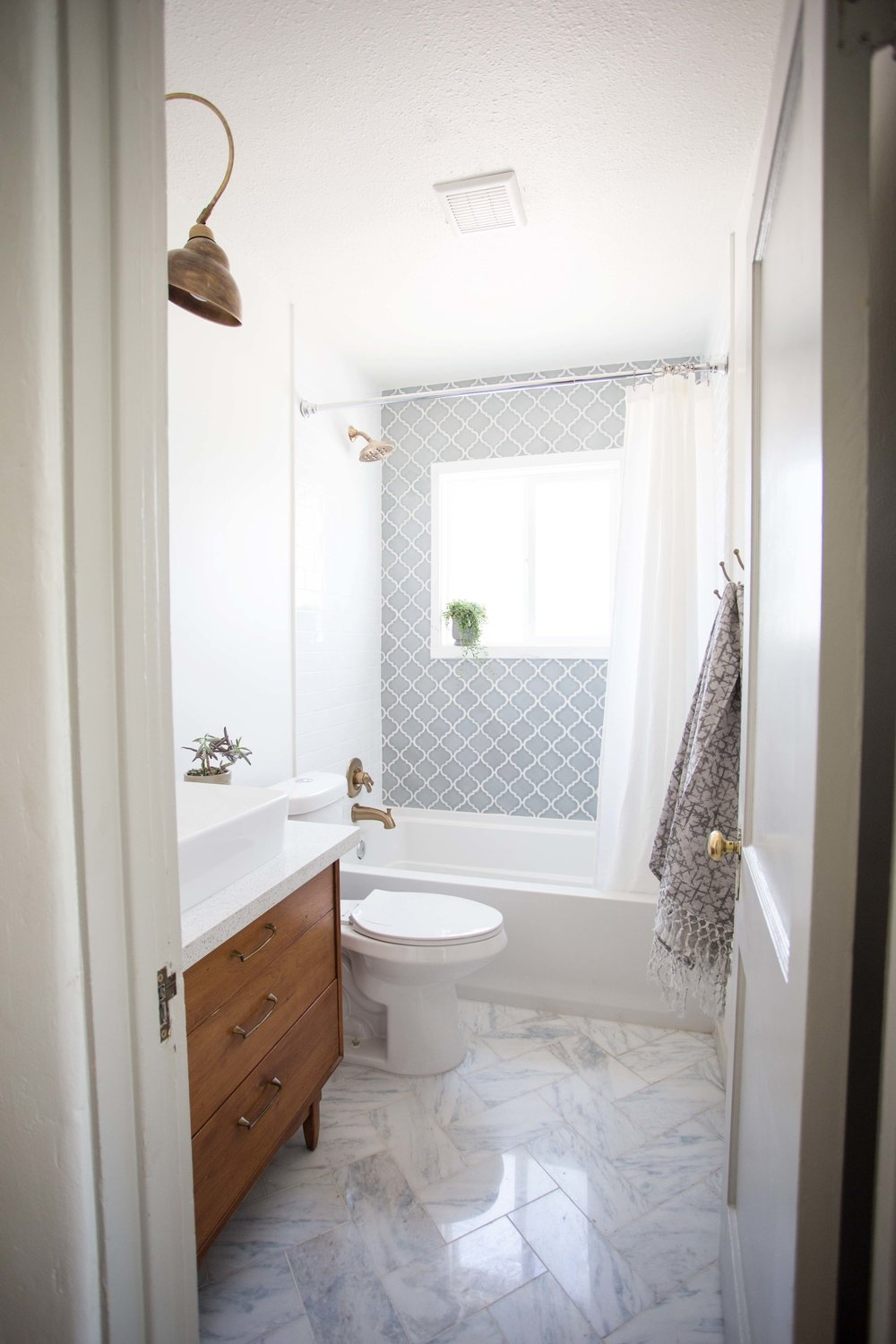 Spanish style bathroom with mid century modern accents