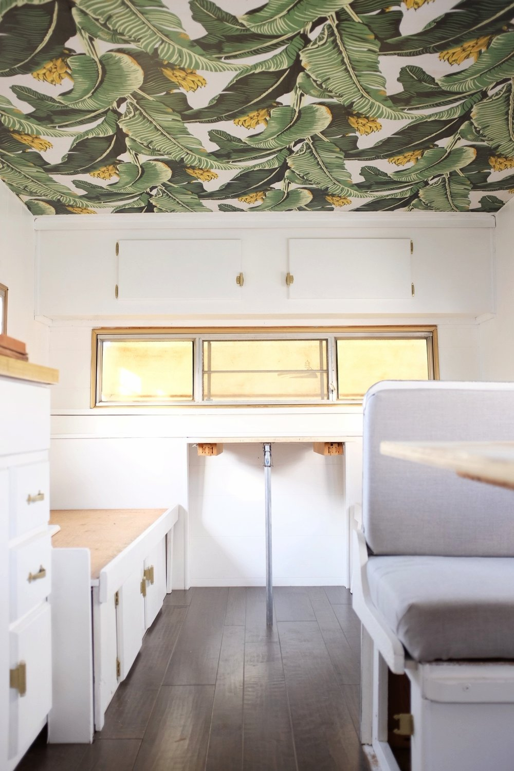 Camper ceiling wallpapered with Milton & King's Jungle Palm