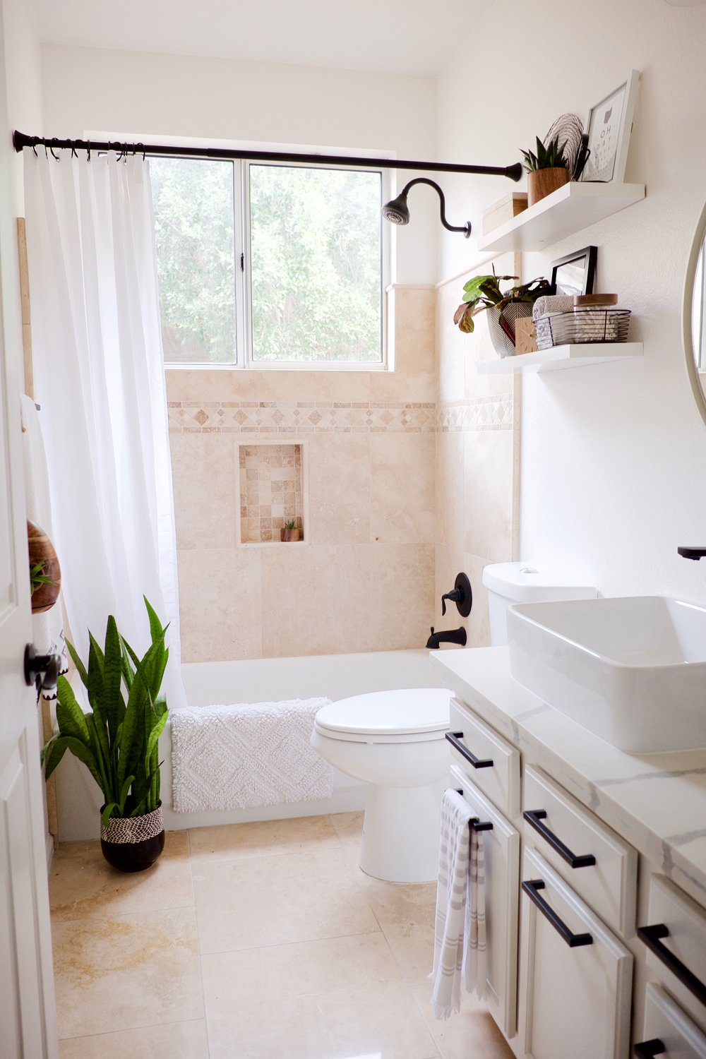 Updating a Travertine Bathroom with white and black