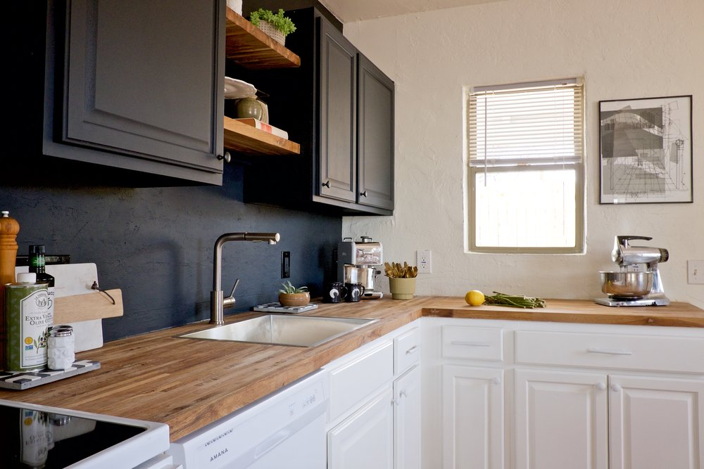 Matte Flat Black kitchen cabinet and painted black backsplash