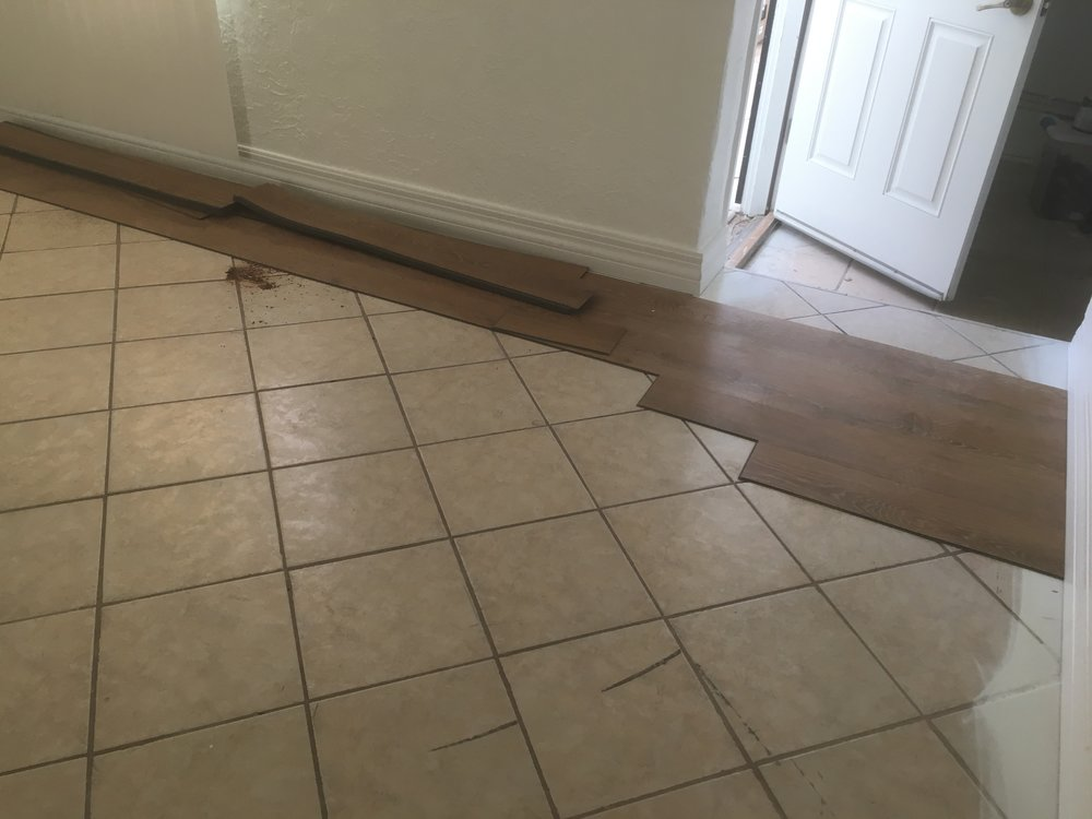 Vinyl planks laid over tile
