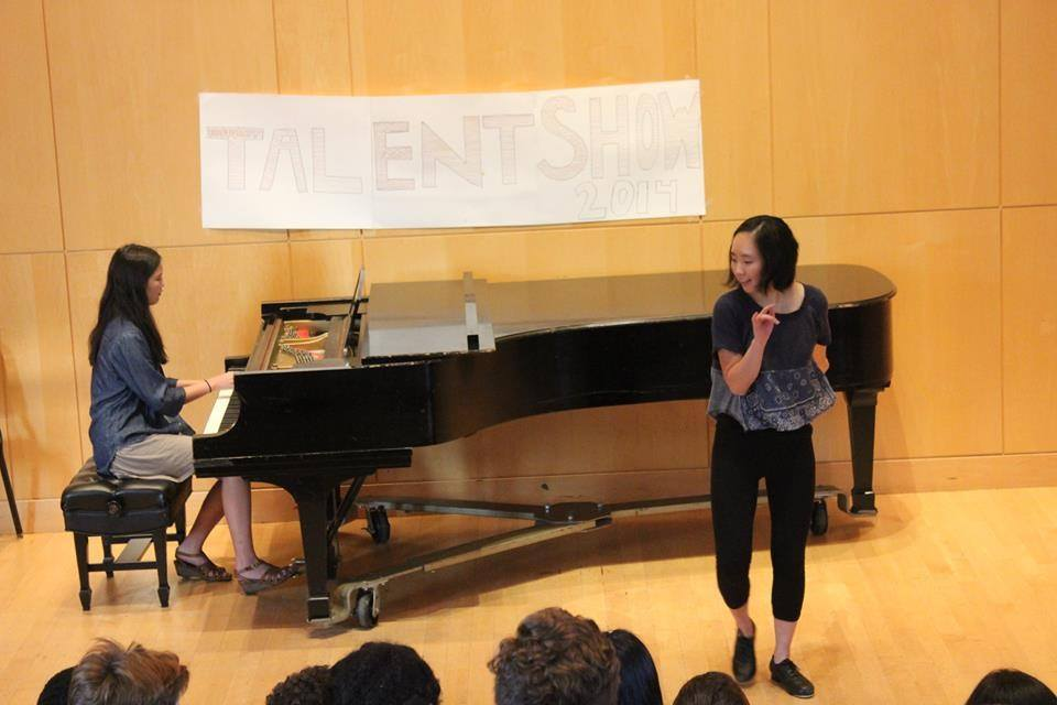 Adroit Summer Mentees Lindsay Emi and Maddie Kim perform at the KRYW Talent Show
