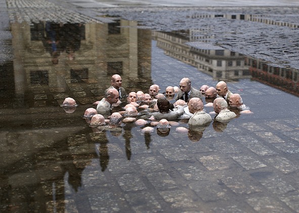 Isaac Cordal: 'Politicians Debating Global Warming'. Berlin, Germany