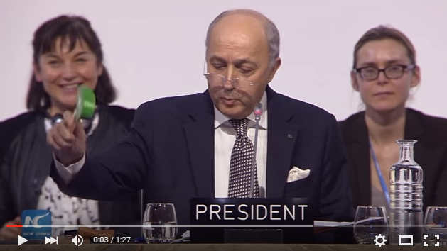 Laurent Fabius, COP-21 President and French Foreign Minister, strikes the gavel signalling adoption of the Paris Agreement. 12 December 2015