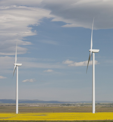 Two large wind turbines in Alberta. Tower height of each: approximately 80 metres.