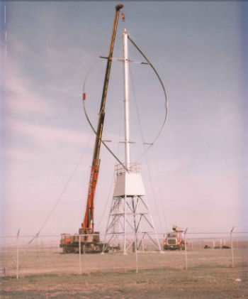Installation in 1978, at the Agriculture Canada Research Station near Swift Current, of Saskatchewan's first wind turbine: a 50 kW, 2-bladed Darrieus VAWT   Source: Mike Sulatisky of SRC