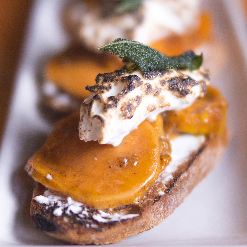 Thanksgiving Bruschetta. This dish is one of the biggest culinary surprises of my life. It is so special, you won't find this anywhere else! Candied yams, chèvre, torched marshmellow, and fried sage. I don't like candied yams, I don't like marshmellow, but this is one of the best things I have ever tasted!