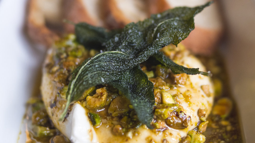 Smoked maple, toasted pistachio, fried sage, and truffle adorn this Warm Burrata.