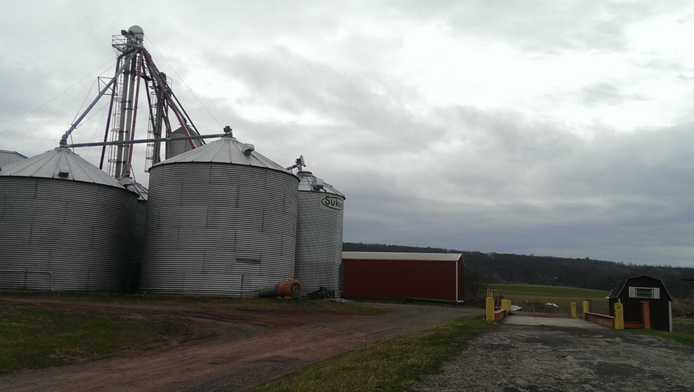 A photo from my first visit to pick up grain at Small Valley Milling. The mill is in the foreground and the newly planted fields can be seen in the background