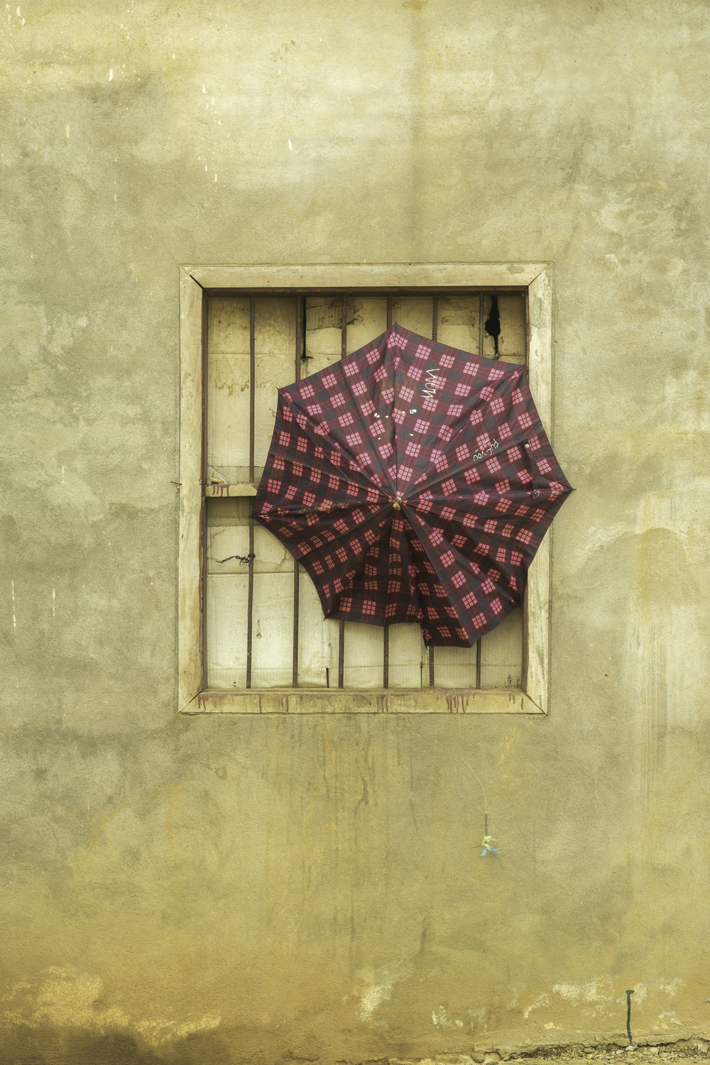 Lonely-umbrella-windows-Laos.jpg