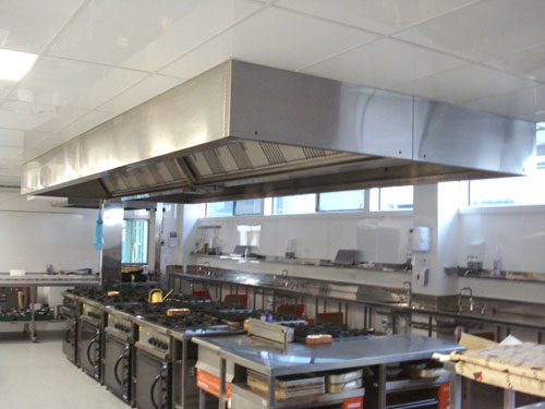 Exhaust hoods in commercial kitchens cause a negative pressure to remove smoke from the room. To high of a negative pressure will result in HVAC run time. To little pressure will result in a smoky kitchen and dinning room. These hoods have to be carefully balanced. It will effect efficiency and higher energy bills.