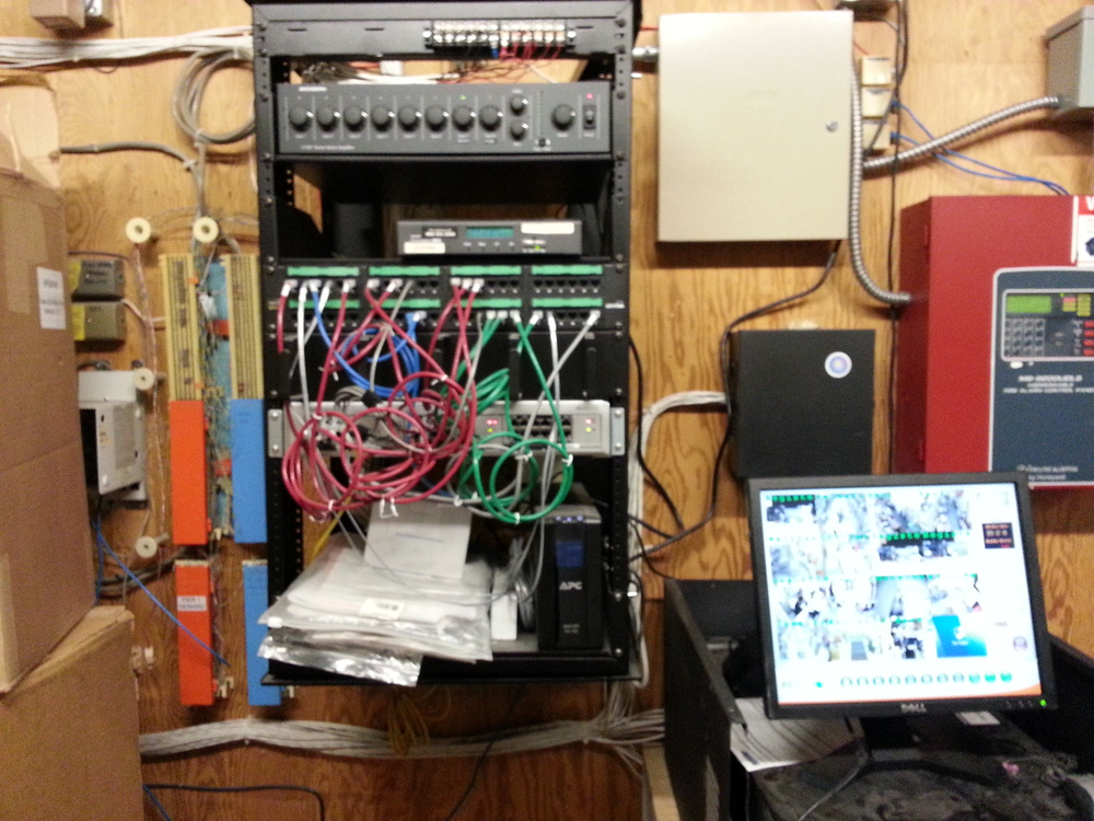 Communications backbone in commercial businesses can be done better than the picture above. . This is a typical wiring mess we run into all the time.     We trouble shoot network wiring issues for commercial locations.