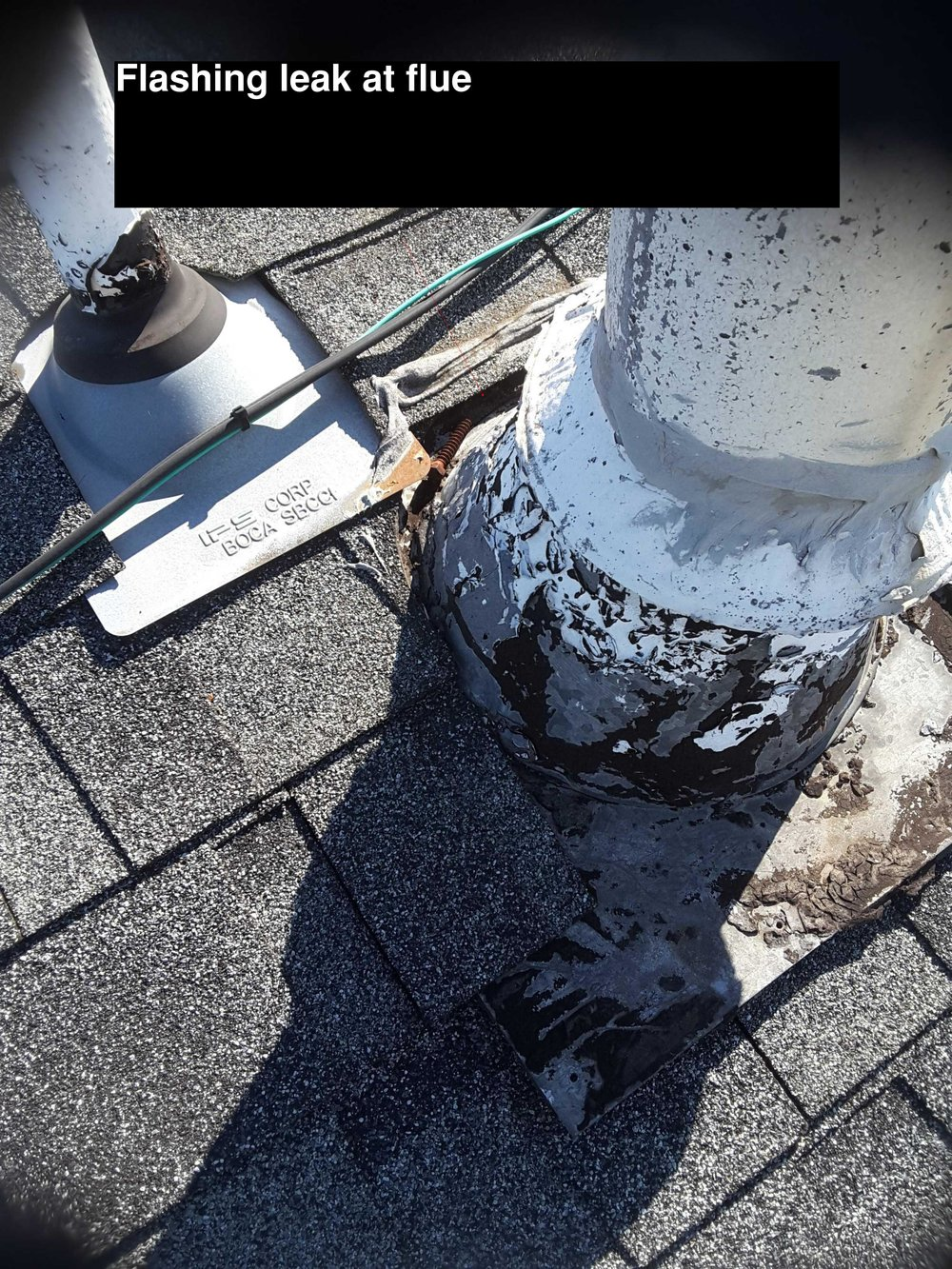 Roof Leak - When inspecting the interior mechanical room I observed a ceiling stain around the flue.