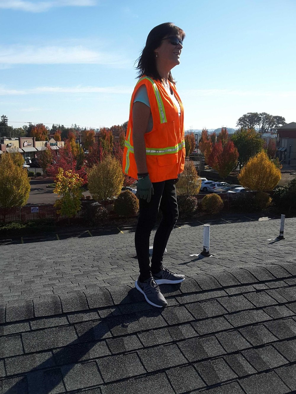 Wife inspector on commercial roof