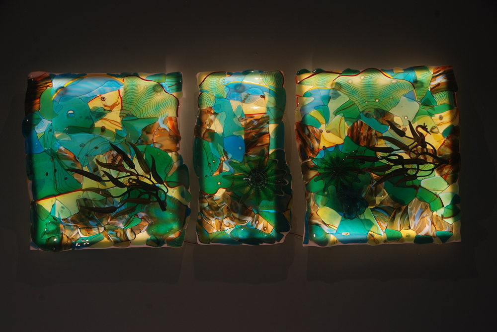 Another shot of this new Triptyck of Fused Glass,  Slumped, and Illumniated with state of the art LED's.  There are some three dimensional features that include some blown glass shells, rondels, and some radical kelp and seahorse torch work by master  Jupiter Nielsen, Maui.  2014