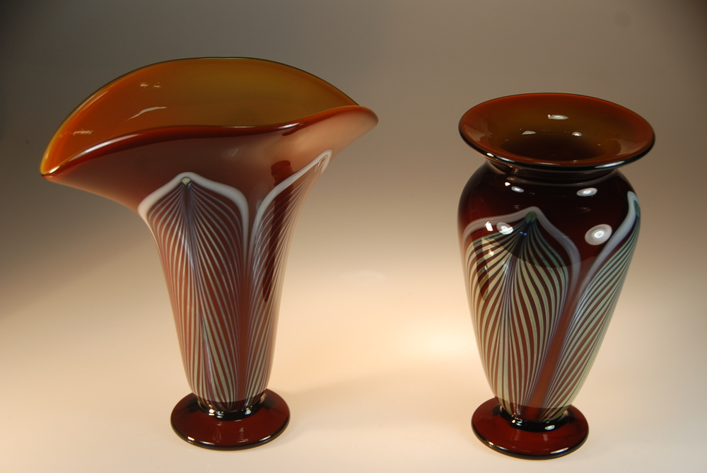 "A couple of Honey Amber vases with the hand decorated ""feather Pattern"" going out for gifts.  circa 2014  On the left is a ""Fan"" vase and the right is a ""high shoulder"" vase  signed and dated by rick strini"