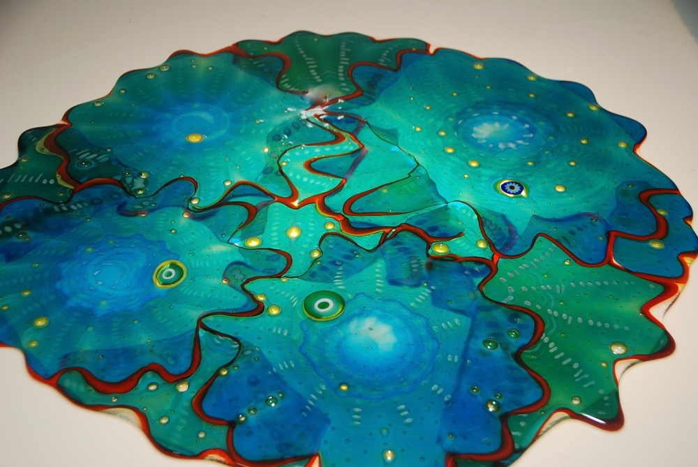 "24"" platter of fused glass blown rondels.  next step is slumping.  artist rick strini 2016"
