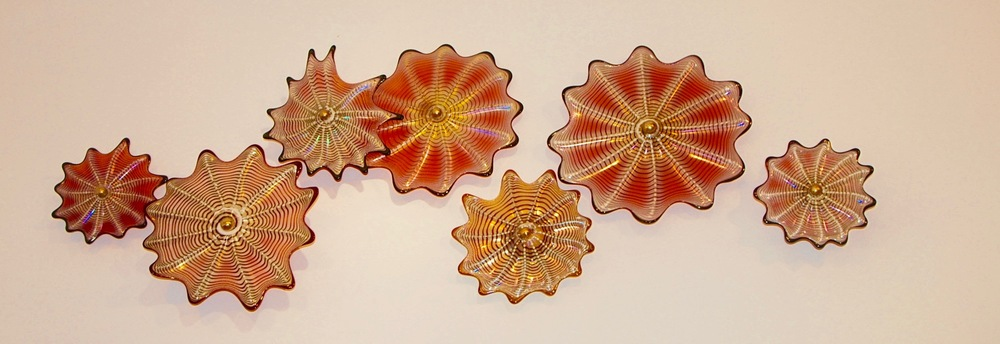 Rondel Wall Splash 7 piece Florentine gold ruby and black and Amber lips.   rick strinisee it at Amazon/Handmade/strini-art-glass